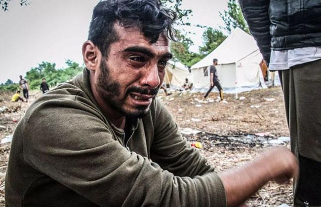 Flüchtling auf Mülldeponie